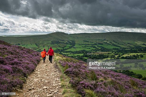 a couple hand in hand walking in the hills - peak district national park stock pictures, royalty-free photos & images