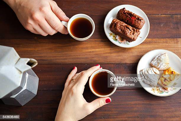 Couple hands about to drink coffee