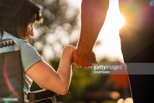 couple hands during sunset - adult stock pictures, royalty-free photos & images