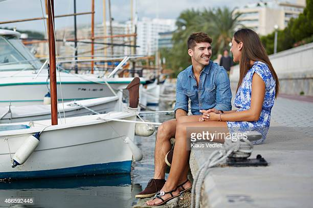 couple hanging out at small harbor - klaus vedfelt mallorca stock pictures, royalty-free photos & images