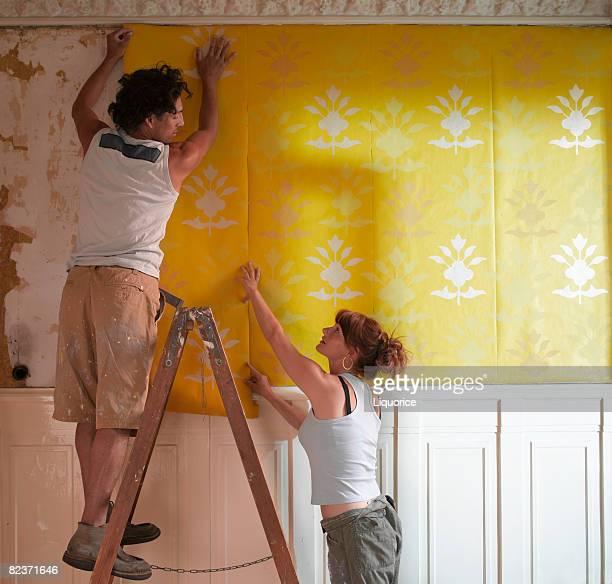 couple hanging wallpaper