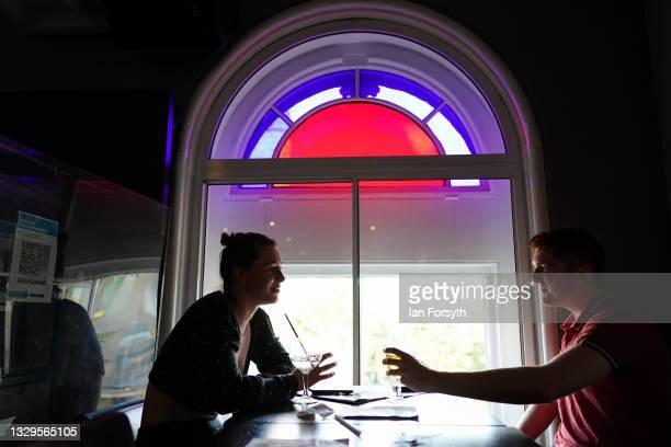 Couple have a drink in the Mile Castle pub on Freedom Day on July 19, 2021 in Newcastle upon Tyne, England. As of 12:01 on Monday, July 19, England...