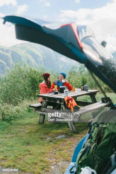 Couple have breakfast in mountains in Norway