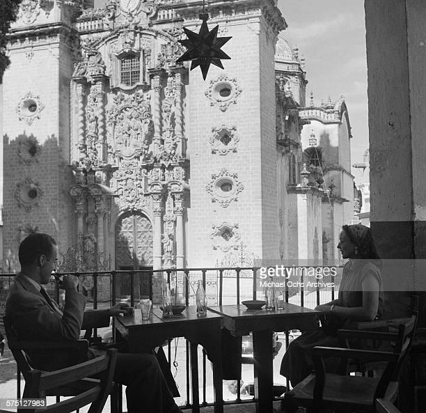 A couple have drinks across from the Cuernavaca Cathedral in Cuernavaca Mexico