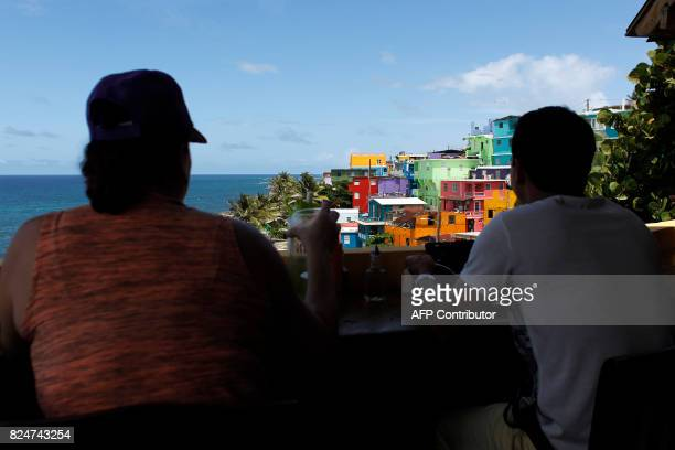 A couple have lunch in a restaurant overlooking the neighbourhood of La Perla where the video 'Despacito' was recorded in San Juan on July 22 2017...