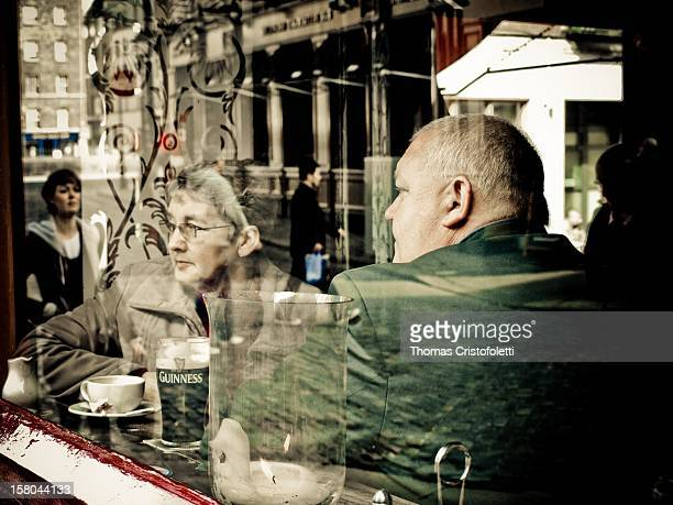Couple having a beer in a Pub in Dublin .