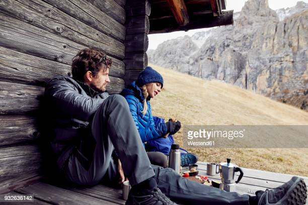 couple having a break at mountain hut - shack stock pictures, royalty-free photos & images