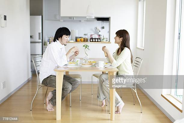 couple having a breakfast - man eating woman out ストックフォトと画像