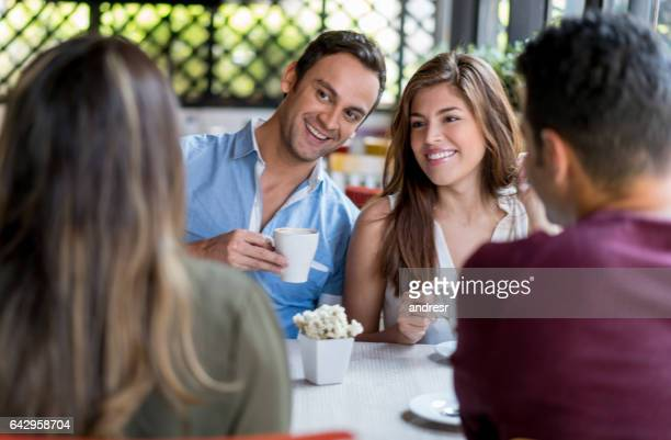 Couple having a cup of coffee with friends