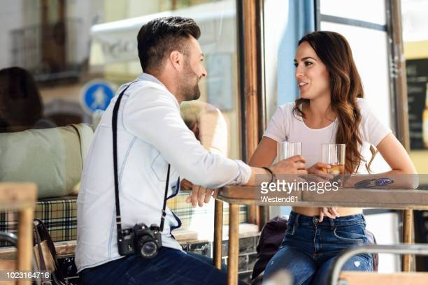 couple having a drink at an outdoor bar in the city - sidewalk cafe stock pictures, royalty-free photos & images