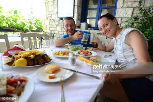 Couple having a lucn in traditional greek taverna, Monodendroni village, Zagoria / Epirus, Greece