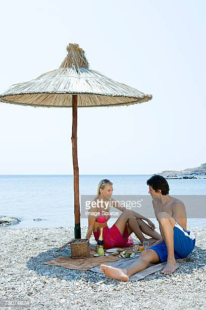 Couple having a picnic by the sea
