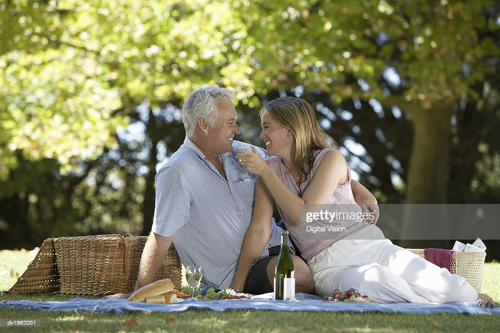 Couple Having a Picnic in a Park : Stock Photo