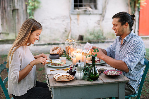 Couple having a romantic candelight meal next to a cottage - gettyimageskorea