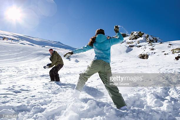 Couple having a snowball fight
