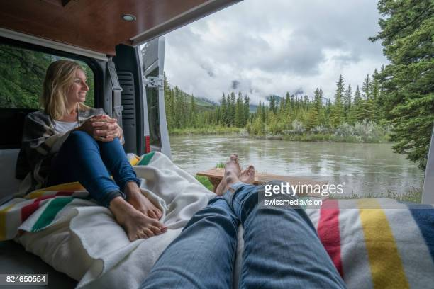 Couple having a stunning view out of the back of their Camping Van