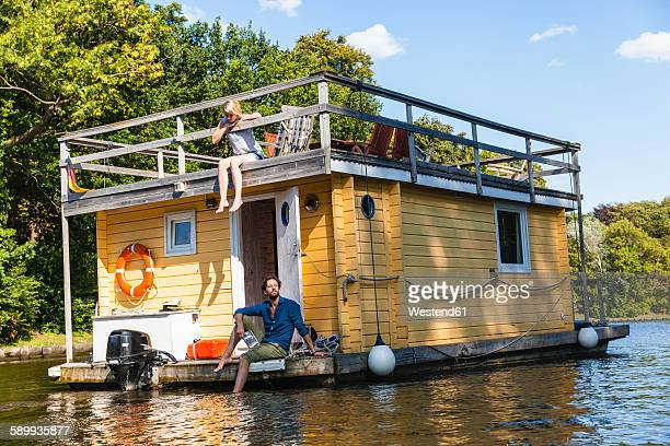 couple having a trip on a house boat - houseboat stock pictures, royalty-free photos & images