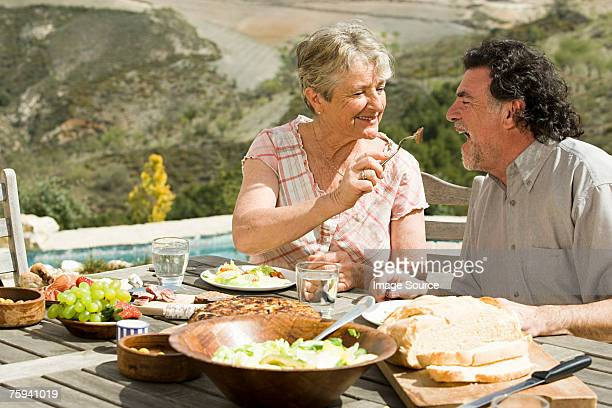 couple having al fresco meal - mediterranean food stock pictures, royalty-free photos & images