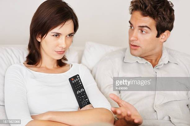 Couple having an argument over the remote control