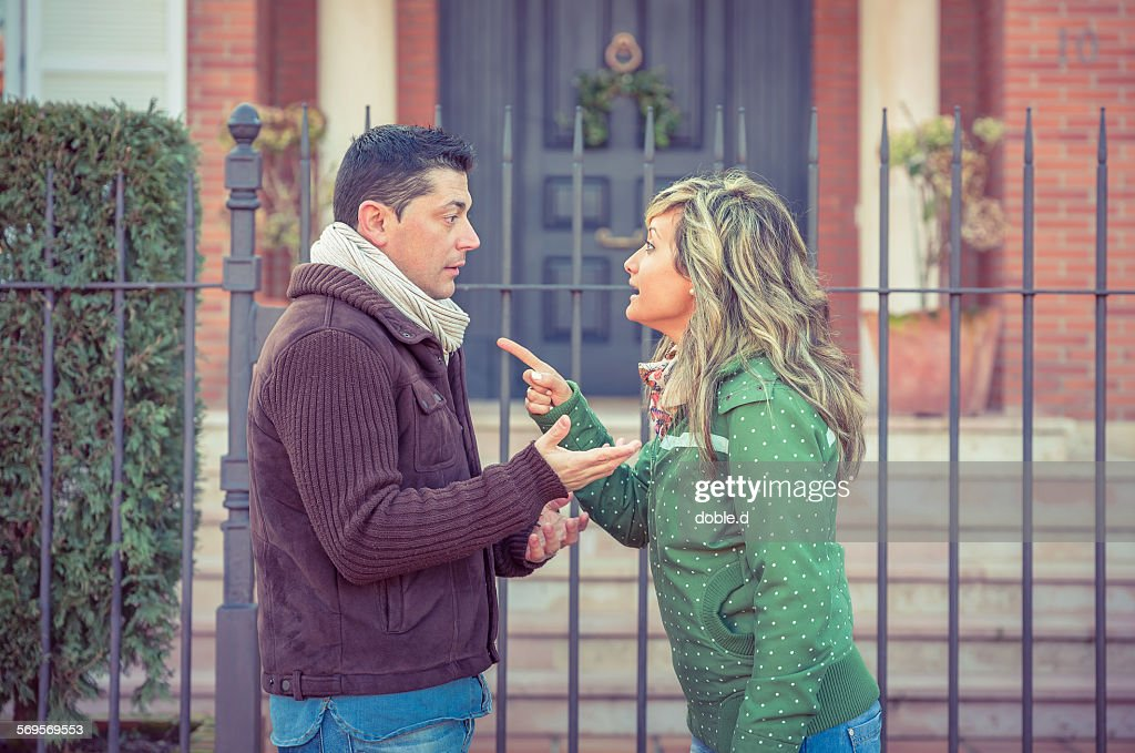 Couple having argument in a hard quarrel outdoors : Stock Photo
