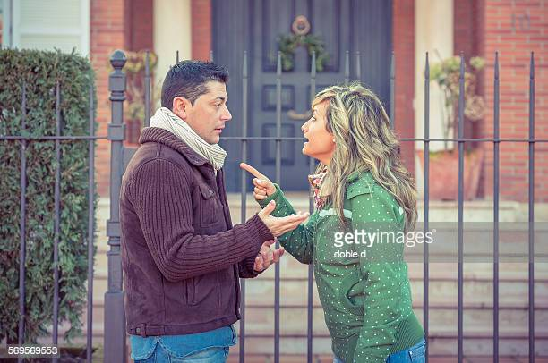 Couple having argument in a hard quarrel outdoors