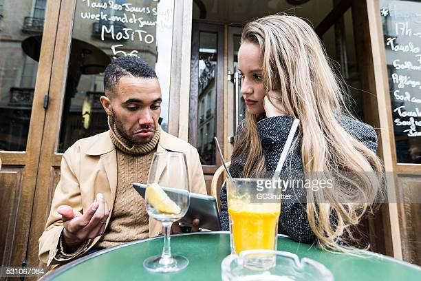 couple having argument over a holiday booking! - paris fury stock pictures, royalty-free photos & images