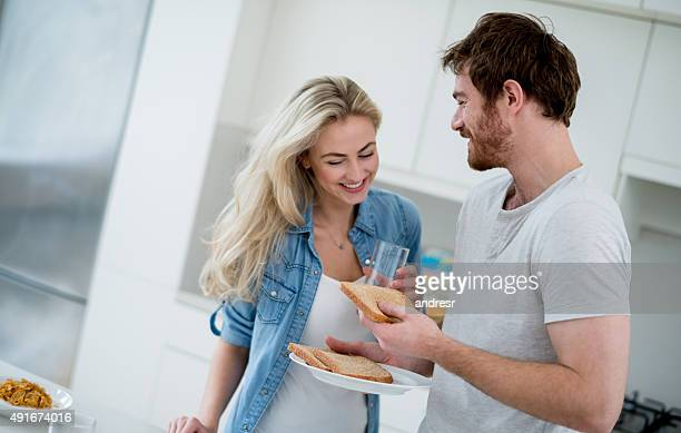 Couple having breakfast and making toasts