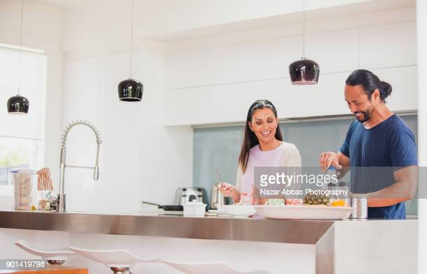 Couple having breakfast at home.