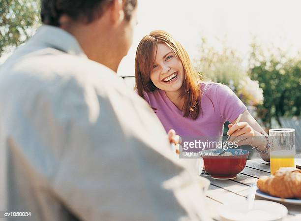 Couple Having Breakfast in Their Garden in Summer