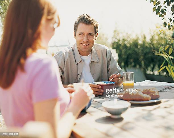 Couple Having Breakfast in Their Garden in the Summer
