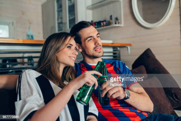 couple having celebratory toast - sports jersey stock pictures, royalty-free photos & images