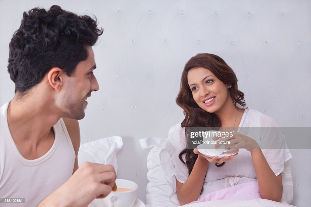 Couple having coffee in bed : Stock Photo