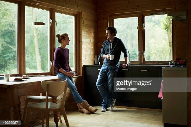 Couple having coffee in cottage