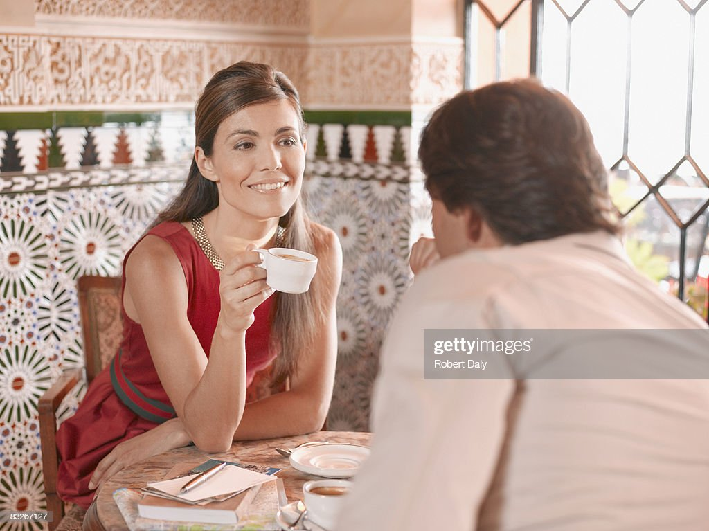 Couple having coffee in exotic cafe : Stock Photo