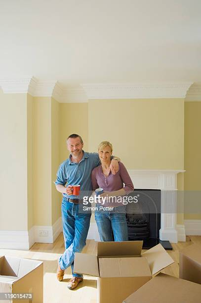 Couple having coffee in new home