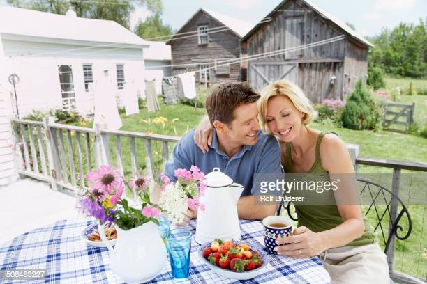 Couple having coffee on patio