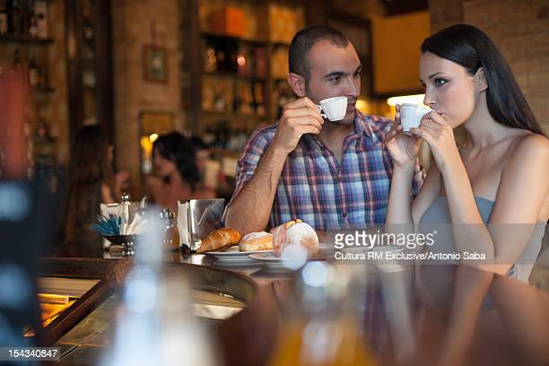Couple having coffee together in cafe