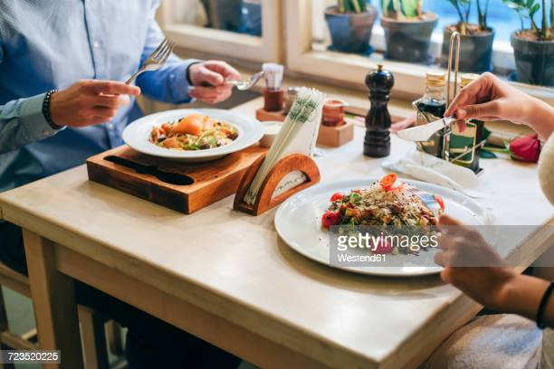 Couple having dinner in a restaurant, partial view