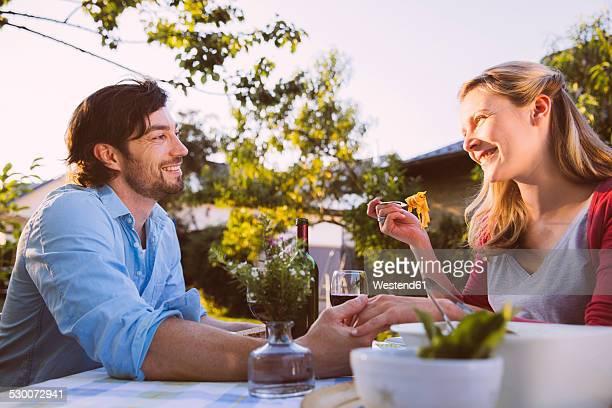 Couple having dinner in garden