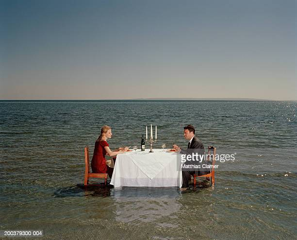 couple having dinner in middle of ocean, side view - candle in the dark imagens e fotografias de stock