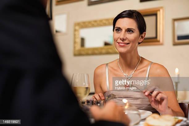 couple having dinner in restaurant - elegante kleidung stock-fotos und bilder