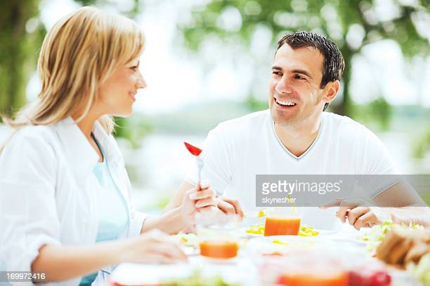 Couple having dinner outdoors.