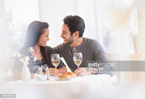 Couple having dinner together in restaurant