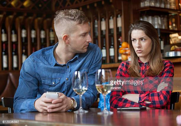 Couple having disagreement in caffe