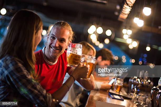 Couple having drink at the bar