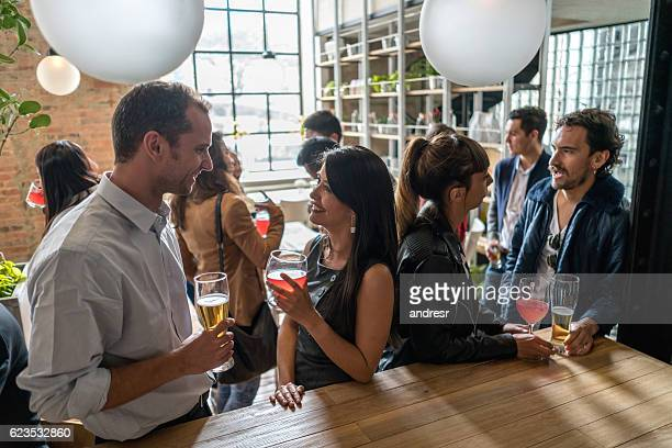 couple having drinks after work - wiedersehenstreffen stock-fotos und bilder