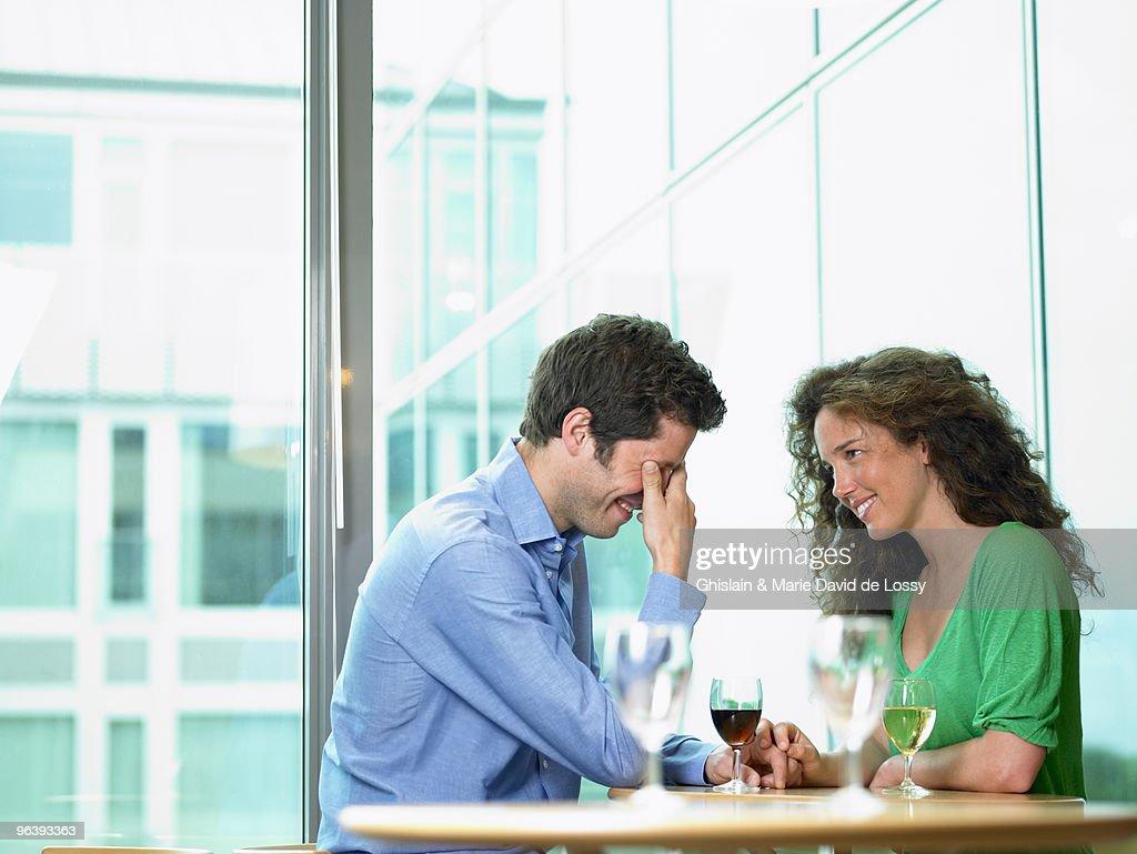 Couple having drinks : Stock Photo