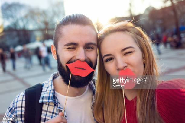 couple having fun and making selfie - big lips stock photos and pictures