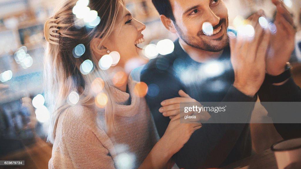 Couple having fun at coffee house. : Stock Photo