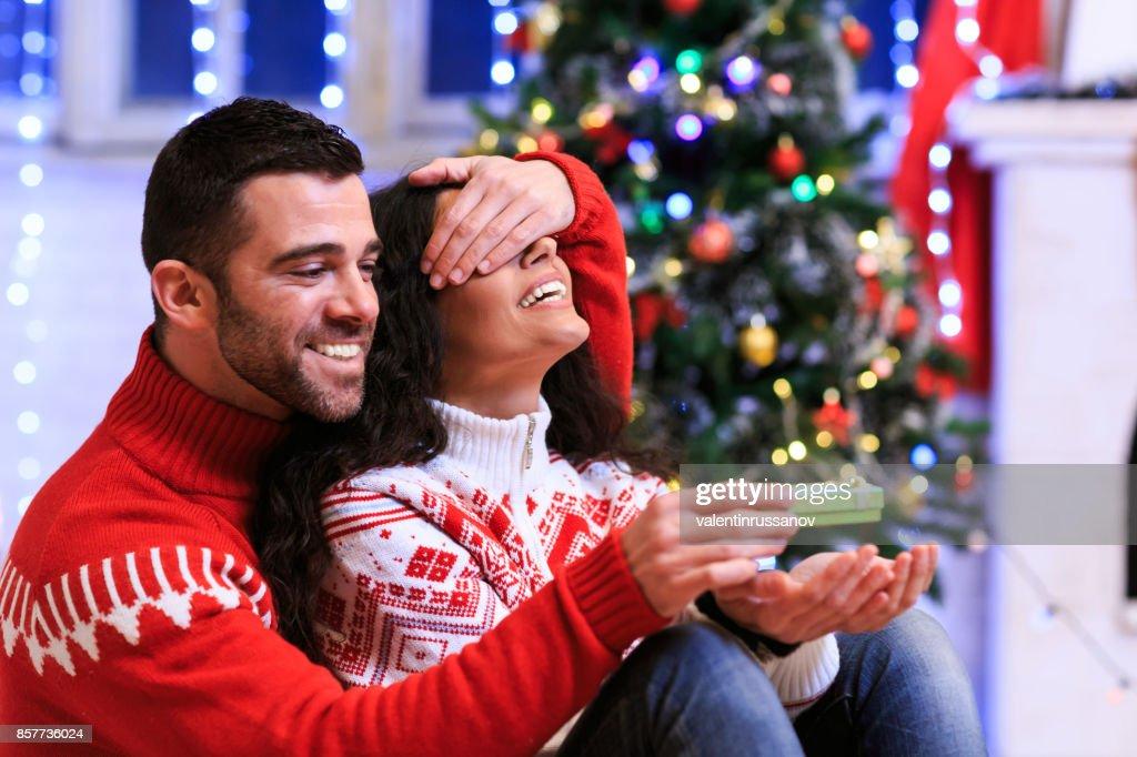 Couple having fun at home for Christmas : Stock Photo